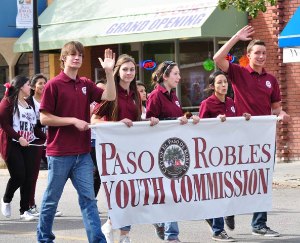 Members of the Paso Robles Youth Commission proudly display their banner along the parade route.
