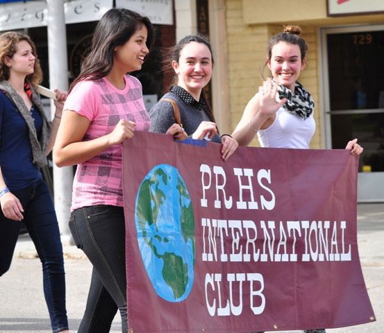 PRHS International Club members wave to onlookers.