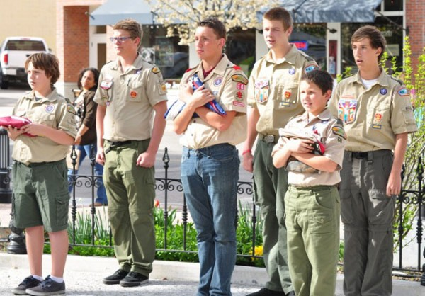 PR Scout Troop 60 members prepare to lift & install the new city flags.