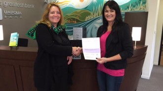 Umpqua Bank's Assistant Vice President of the Central Coast Agriguclture and Commercial Banking Center Ashley Ogden presents the donation to Manager of Community Engagement for Girl Scouts of California's Central Coast  Laura Romano.