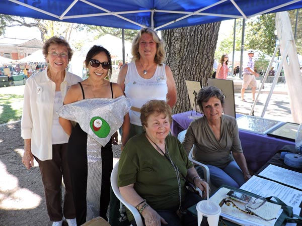 The ladies of the Main Street Association, who organize the festival, manning the information booth.