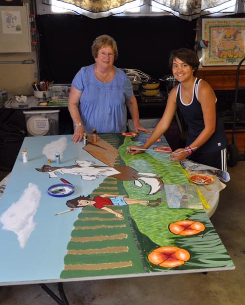 Artist Brenda Thomason with student art contest winner Santana Sanchez.