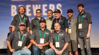 Photo by John Holzer.  Back row, left to right: Patrick Hayes, brewer, Atascadero ; Robert Emery, sensory analyst lab technician, Atascadero; Charlie Papazian of the Brewers Association; Grandpa Brynildson, Minnesota; Matt Brynildson, brewmaster, Paso Robles; Tim Miller, brewer, SLO. Bottom row, left to right:  Ryan Hamill, Brewer, Grover Beach; Dustin Kral, head brewer, SLO; Jason Pond, cellar manager, Atascadero.