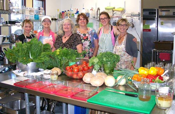 Volunteers preparing nutritious food for the Wellness and Healing Foods programs. Courtesy photo.