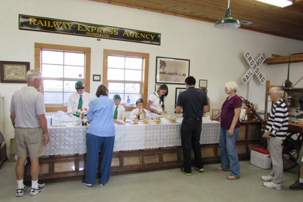 Pie and cake, compliments of the the Templeton Historical Museum Society, was another attraction. Volunteers from the Templeton 4-H Club served as quickly as possible as the line stretched from Main St. Into the the restored 1886 Railroad Warehouse.