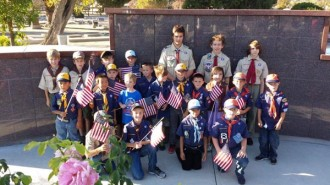 Cub Scouts and Boy Scouts from Templeton Troop and Pack 434 Decorating Graves of Veterens in Templeton
