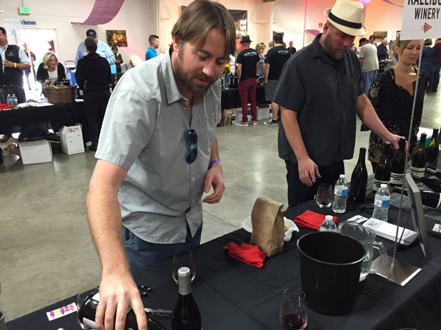Winemaker Jacob Toft pours his petite sirah.