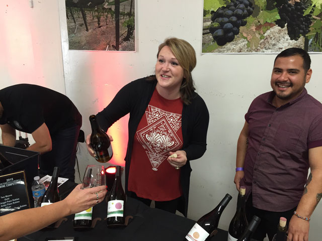 Amber Bierwirth and Daniel Boone pour wine from Moon Cellars, a wine label from Clavo Cellars in Templeton.