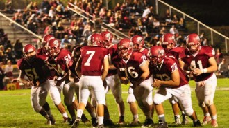 Quarterback Justin Davis, center, calls out the plays during Paso Robles' 30-0 shut-out win over Righetti last week. Davis and his fellow Paso Robles High School Bearcats will host the rival Atascadero Greyhounds on Friday, Nov.  6 at War Memorial Stadium. JV action starts at 4 p.m., with the Varsity players taking the field at 7 p.m. Photo by Meagan Friberg