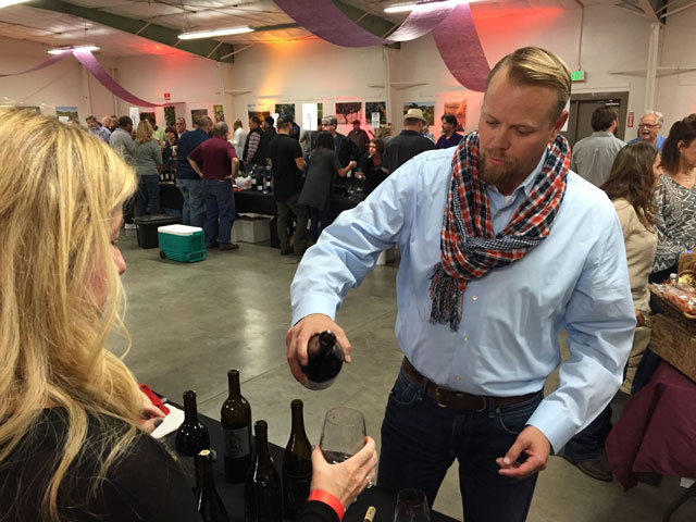 Winemaker Ryan Render pours a selection from his Rendarrio Vineyards