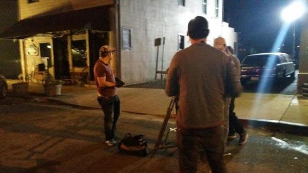 Camera men on the scene of Amy Allen's 'walkthrough' of the saloon.