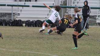 Robles battling for the ball against a Cabrillo player before scoring a goal. Photos by: Megyn Rugh.