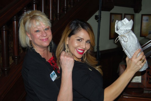Paso Robles Chamber volunteers Hope Cornejo, left, and Valerie Gonzales sell bottles of wine to attendees.