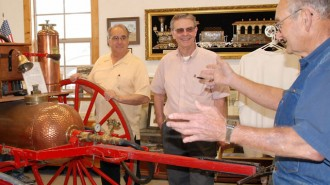 "Atascadero Mayor Tom O'Malley, at left,  and Paso Robles Mayor Steve Martin, center, listen as Daryl Radford describes the antique fire wagon displayed in the restored Templeton Train Depot. Martin and O'Malley support many local activities jointly and refer to themselves as ""Dos Alcaldes"", Spanish for ""two mayors."" They even have their own website at www.DosAlcaldes.com."