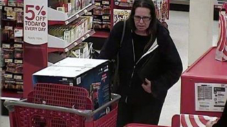 Police are requesting information to identify the forgery suspect, the image was taken at the Paso Robles Target.