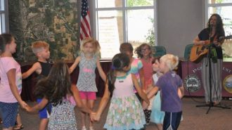 Melissa Green entertains children at the Paso Robles Library in 2015.