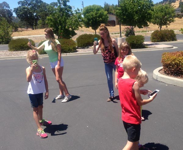 Local children playing the Pokemon Go game.