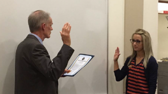 Catherine Piatti getting sworn in by Paso Robles City Manager Tom Frutchey.