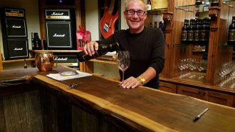 Gary Kramer pouring wine at the new Gary Kramer Guitar Cellars in Paso Robles.