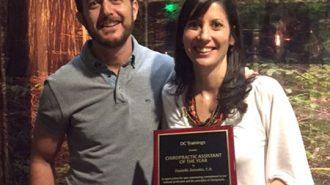 Dr. Darren Hart congratulates Danielle Zeimatis on her award.