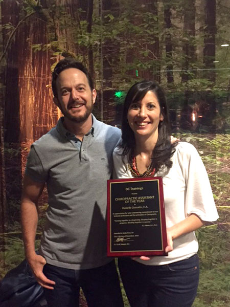 Dr. Darren Hart congratulates Danielle Zemaitis on her award.