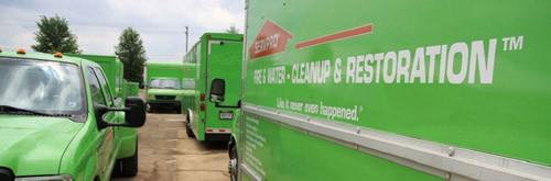 servpro of santa maria- water damage santa maria -green trucks.JPG