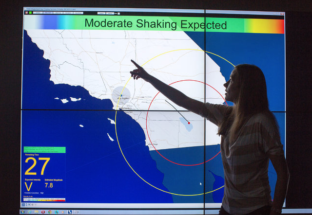 Maren Boese, a research fellow at Caltech, demonstrating an earthquake simulation along the San Andreas Fault (photo: NY Times)