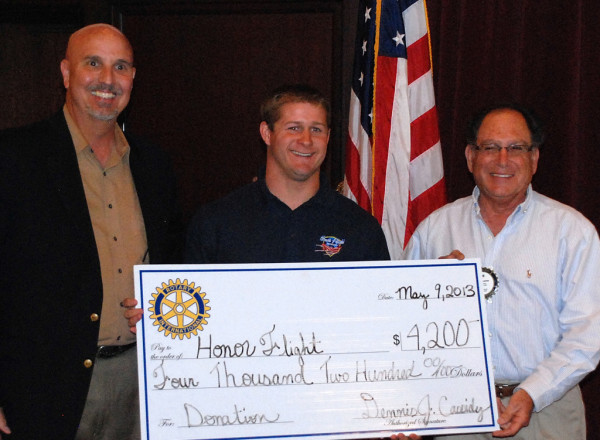 Greg McGill (c), Honor Flight Coordinator, receives a $4,200 check from Paso Robles Rotary from Rick Minton (l) and Tom Apkarian (r).