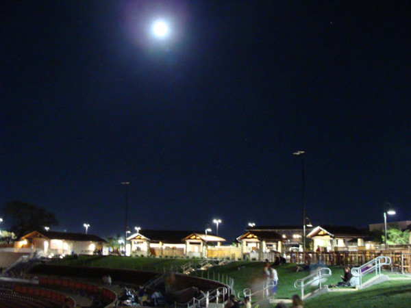 Moon rising over the amphitheater.