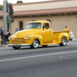 classic truck rolls down Spring Street