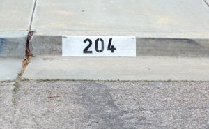 is the city painting address numbers on curb?