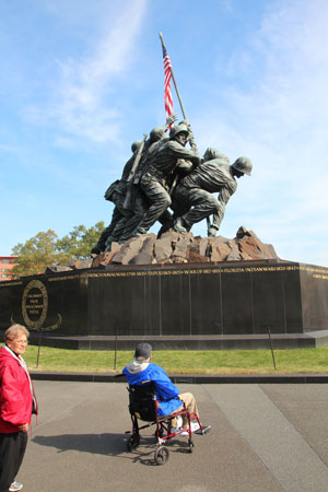 An Iwo Jima Survivor at the Marine Corps Memorial.  He asked to be wheeled to the  back side so he could see it from the same location as where he was standing when he saw the original flag raising on Suribachi. Photo by Rex Thornhill.