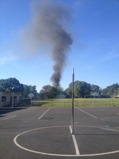 The smoke rising from the fire can be seen south of Georgia Brown Elementary School. Photo by Ana Martha Vidaurri.