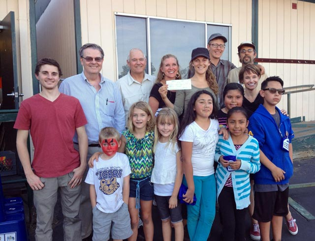 Adults in the photo from left to right: Michael Scott, a Cal Poly intern who co-wrote the application for the school, Paso Robles City Councilman Steve Martin, SLO County Supervisor Frank Mecham, Georgia Brown Principal Ellalina Emrich-Keller, Victoria Carranza of One Cool Earth and USGBC Green Schools Co-Chair, Greg Ellis-Valencia of One Cool Earth, Mike Swettenam, Georgia Brown Garden Coordinator,  Jen McIntyre, IWMA county recycling coordinator and USGBC Green Schools co-chair. Students In the picture are compost and recycling monitors, gardeners, and eco heroes.