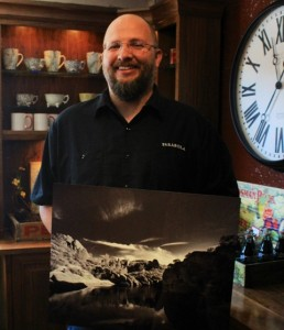 Jason Hickman holds his winning photo for the Pinnacles National Park photo contest. Photo by Heather Young