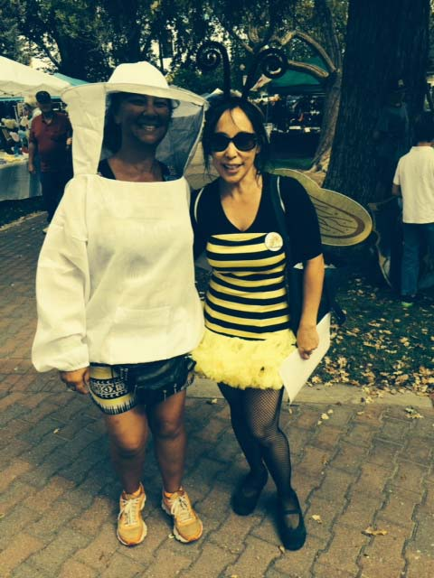 A beekeeper on the left and Jenni Cisco as a bumblebee at last year's festival.