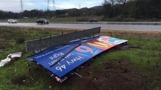 wind knocks billboard down