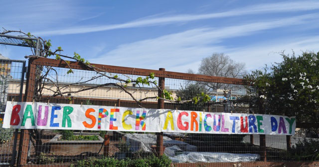 A banner hangs outside the Bauer-Speck Elementary School garden to celebrate Agriculture Day. Photo by Meagan Friberg