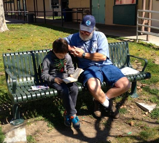 Don Simoneau reads with student Wyatt Moore.