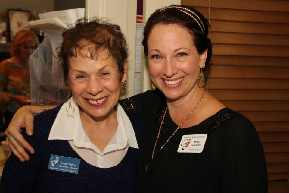 Mindy Sisemore, featured on the right with her arm around volunteer Janice Nelson.