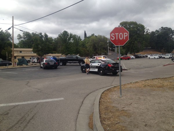 Police cars block access to the high school campus. Photo by Paula McCambridge.