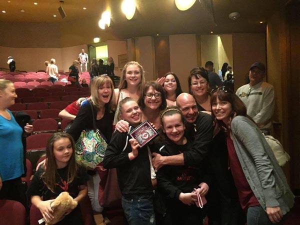 Bob Woodard hugs his team of winning dancers at the Fresno competition. Photo courtesy Bob Woodard.