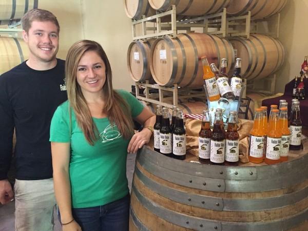 Brice Garrett and Sarah Fleming are selling Paso Pure craft sodas, a Rabbit Ridge Winery product.    Photo by Paula McCambridge