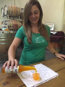 Sarah Fleming pours a sample of her Paso Pure orange cream craft soda.    Photo by Paula McCambridge
