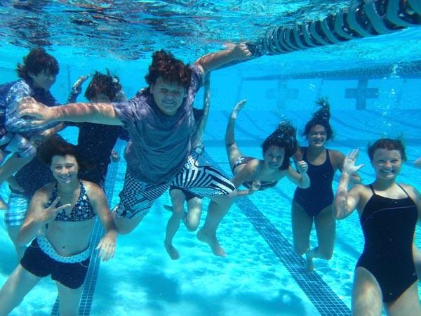 junior lifeguards taking a break underwater