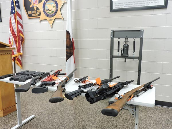 Semi-automatic rifles, handguns, and ammunition were also confiscated.
