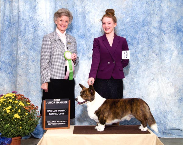 AKC Judge Florence Males presents the award for Best Junior Handler in 2013 to Hannah Firchow. Firchow handled Conifer Stuck on You , aka Linus. Courtesy photo.