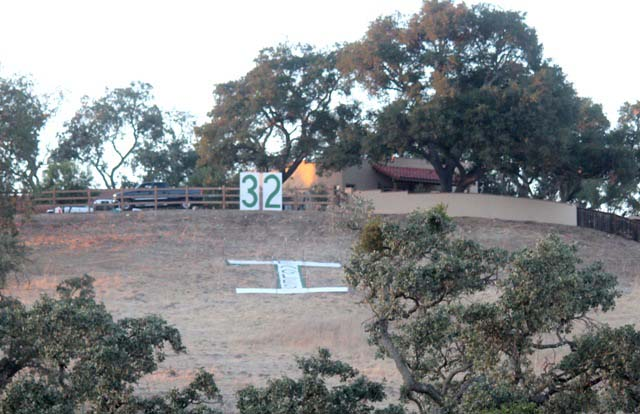 """The infamous """"T"""" on the hill overlooking the Templeton High football stadium has been rearranged into an """"I"""" as a gesture of support for Isaac Lindsey. Photo by Penny Fuentes"""
