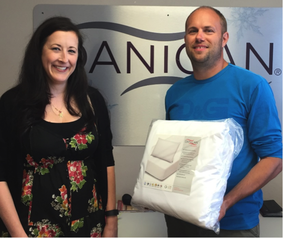 Resident Services Coordinator for HASLO Traci Walker receives donations of Danican Care Packages from Thomas Frismodt, CEO of Danican. Courtesy photo.