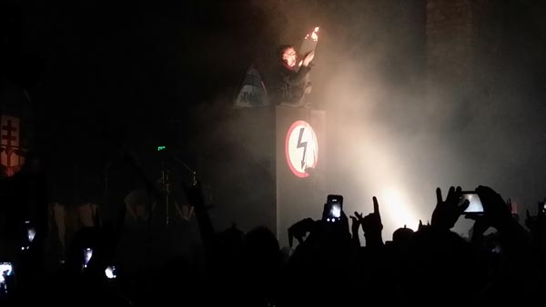 Manson burned a bible at a Hitler-esque lectern.
